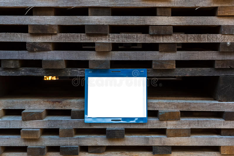 The treated plank stacked in piles to dry, with a blank white sign royalty free stock images