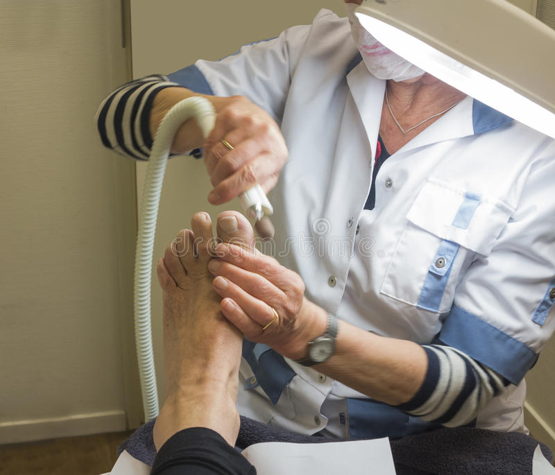 Treating foot by pedicure royalty free stock photography