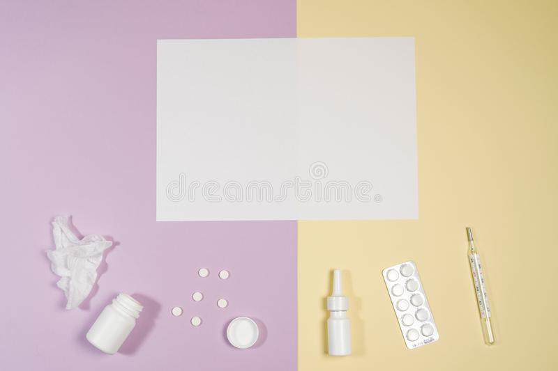 Various medicines, a thermometer, sprays from a stuffy nose and a pain in a throat on a pink background royalty free stock images