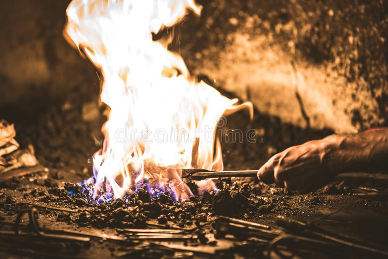 Treatment of molten metal close-up. Handmade blacksmith. In the forge royalty free stock images