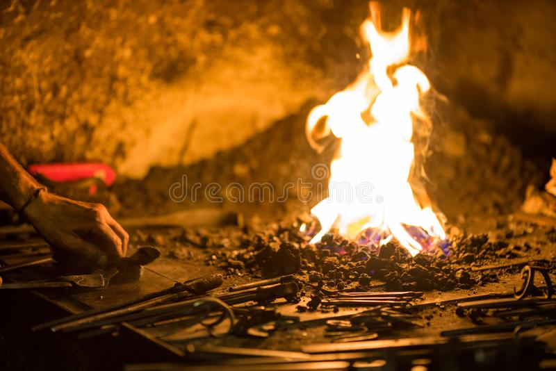 Treatment of molten metal close-up. Handmade blacksmith. In the forge stock photos