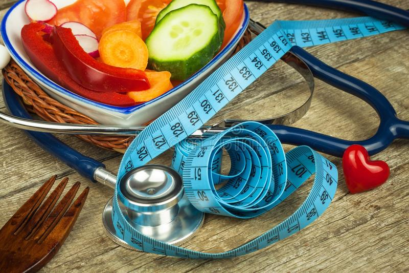 Treatment of obesity. Diet on a wooden table. Healthy vegetables. Treatment of obesity. Diet on a wooden table. Healthy vegetables stock photography