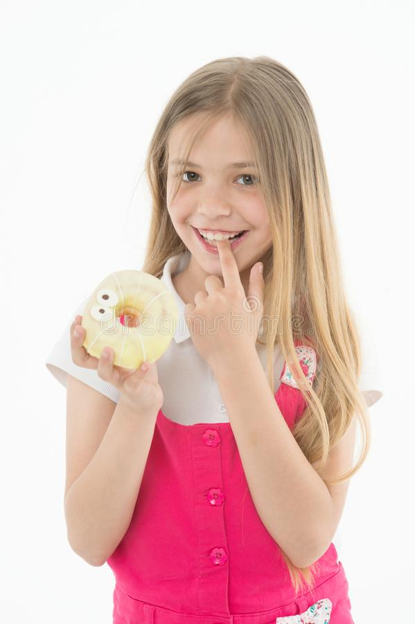 Treats for holidays. Kid rewarded for good behavior with sugary treats. Girl cute smiling face holds sweet donut. Girl royalty free stock image
