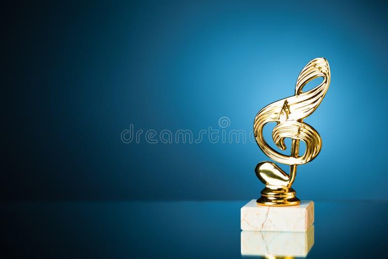 Treble Clef Symbol Trophy On Blue Background Stock Photo Image Of