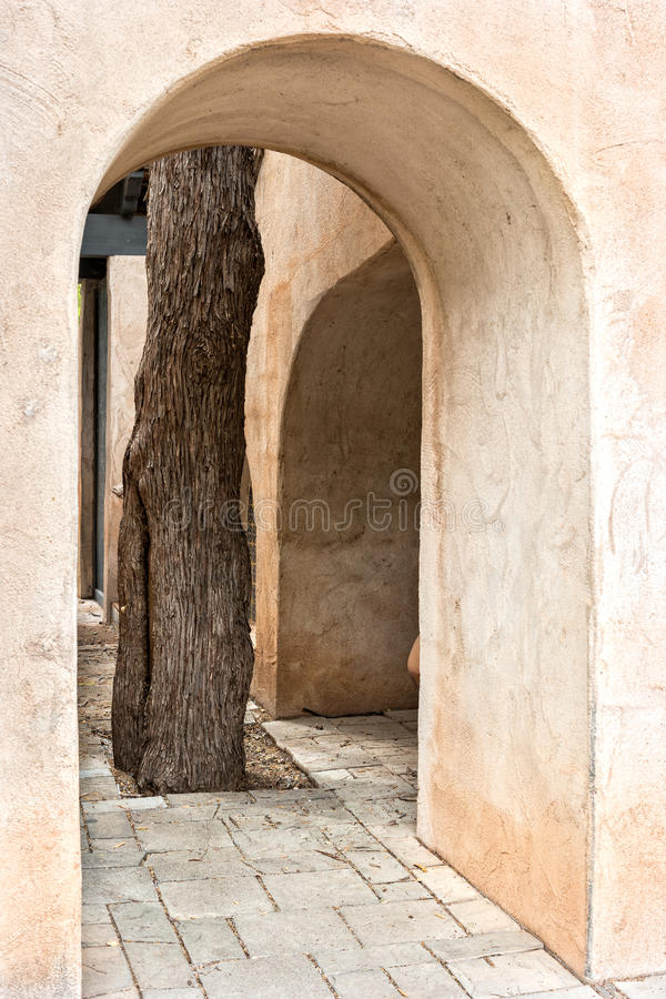 Tree and arched passageway, Tlaquepaque in Sedona, Arizona. Stunning architectural details, Tlaquepaque Arts and Crafts Village royalty free stock image