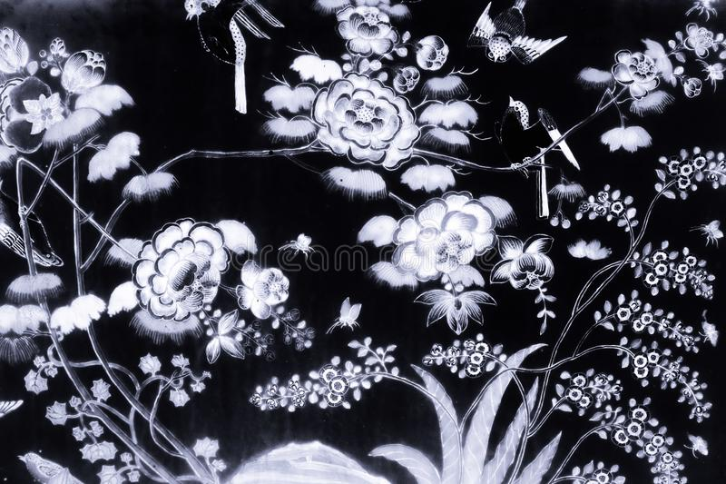 Tree bird and Flowers Art paintings on tile pattern wall and color black and white  isolated along the galleries of the Temple of stock image