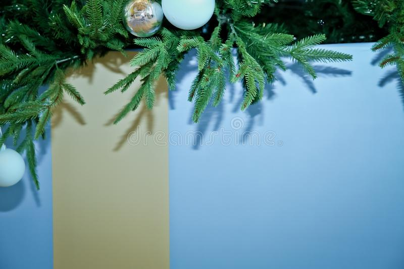 Christmas tree branches with blue baubles, snowflakes on white - horizontal border . Border of Christmas tree. Tree branches with blue baubles, snowflakes on stock images