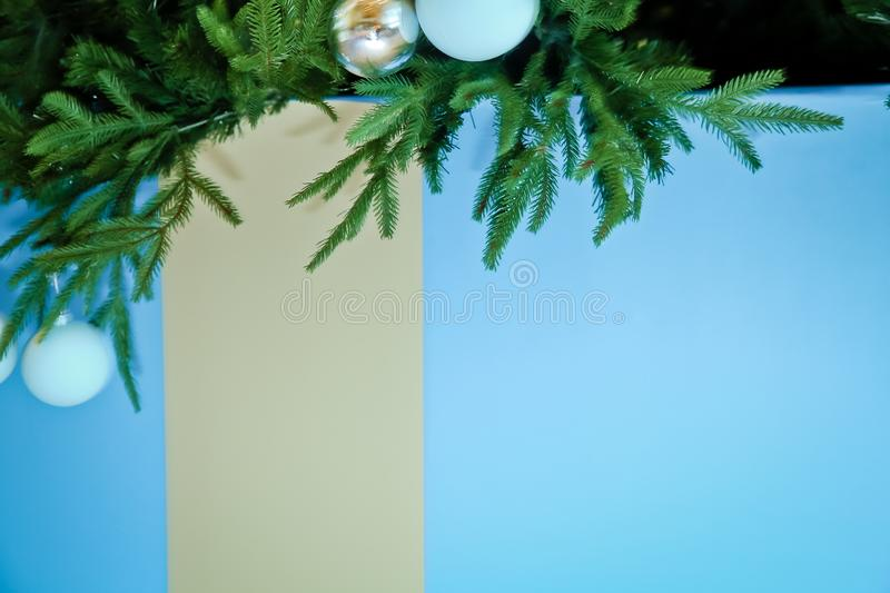 Christmas tree branches with blue baubles, snowflakes on white - horizontal border . Border of Christmas tree. Tree branches with blue baubles, snowflakes on stock photo