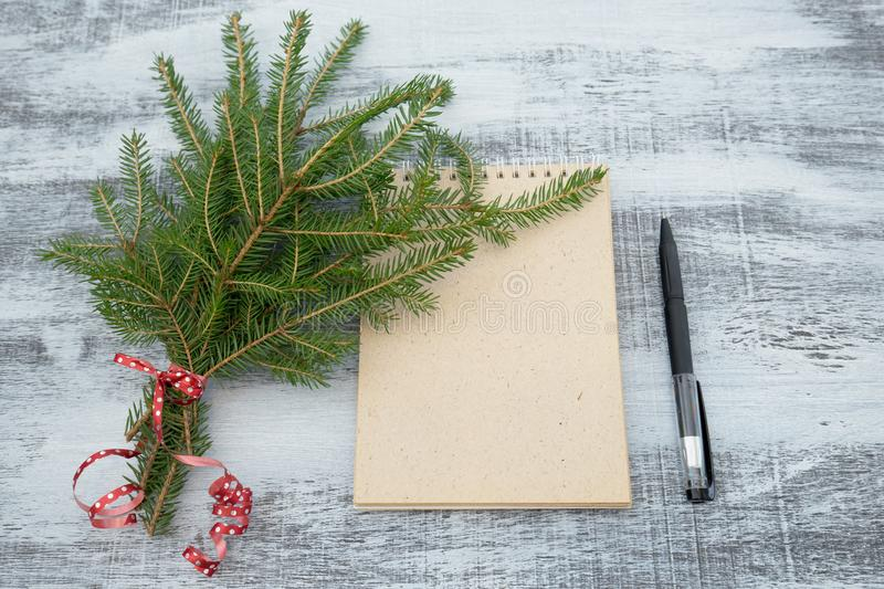 Tree branches and notepad on wooden background stock photos