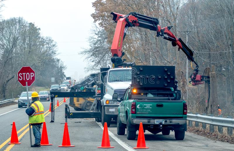 Tree crew works on side of a busy highway stock images
