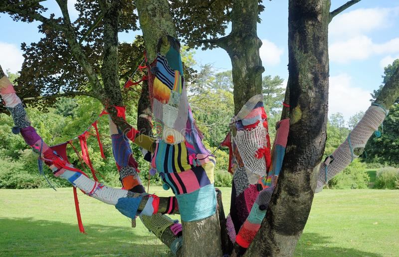 Tree decorated with knitwear knit bomb royalty free stock photo