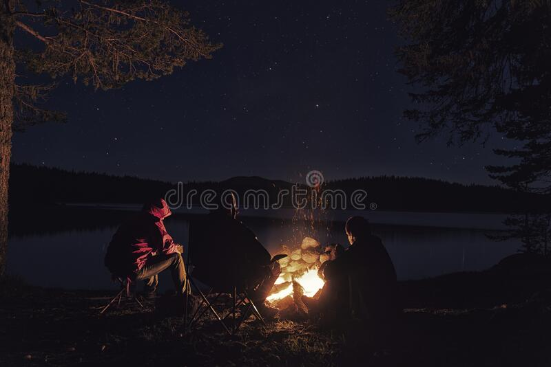 Tree friends near campfire on Sparks Lake shore Bend, Oregon, United States.  stock photography