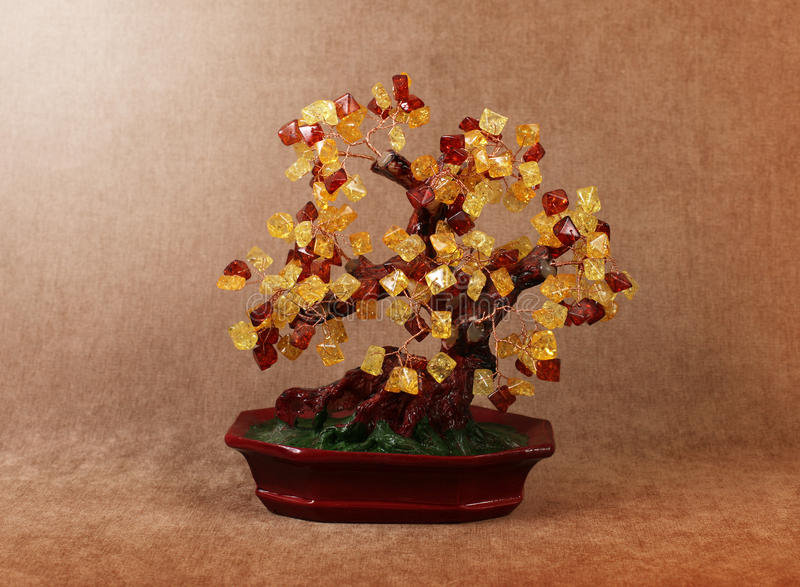 Tree of gems amber. Souvenir for interior - tree of gems amber royalty free stock photos