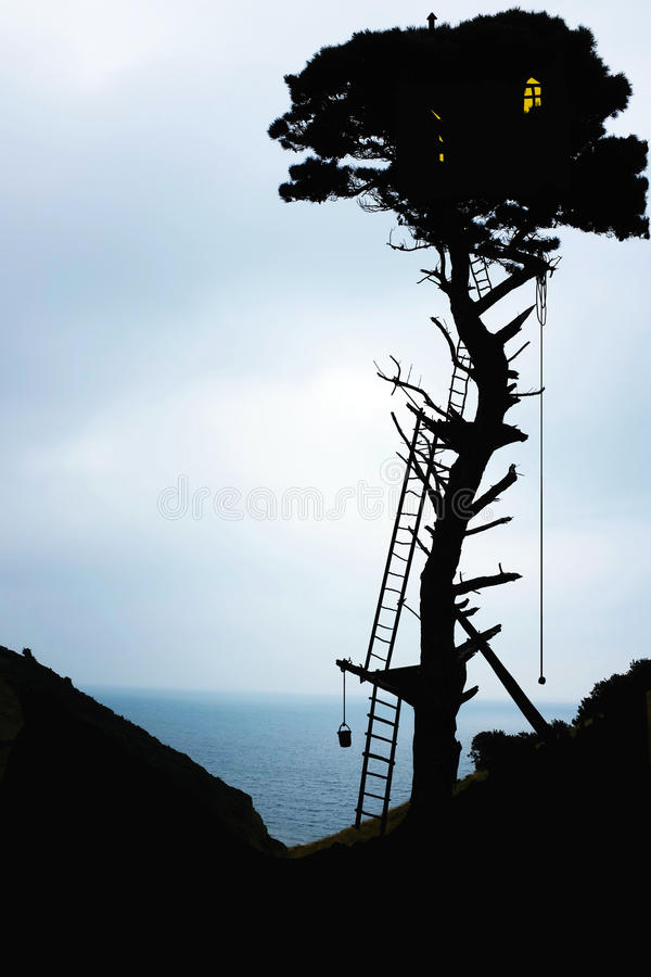 Tree house silhouette stock photo