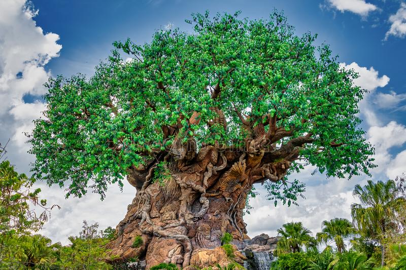The Tree of Life at Disney's Animal Kingdom. ORLANDO, FLORIDA USA. MAY  03, 2019: , art, background, beautiful, blue, carving, forest, green, landscape royalty free stock image