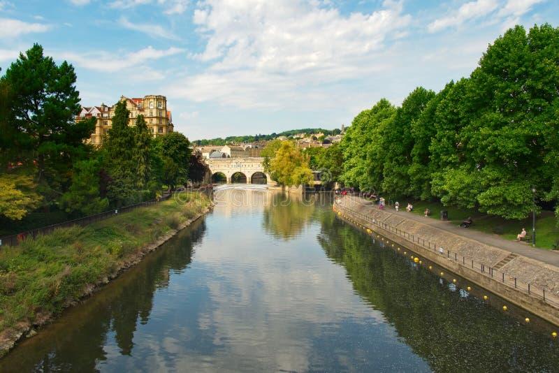 Tree Lined Avon River Looking Towards Pulteney Bridge Bath England UK royalty free stock photography