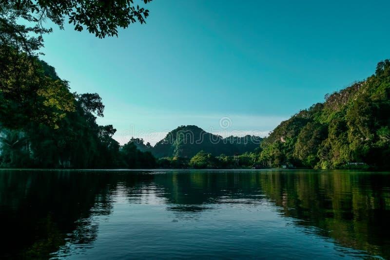 Tree lined lake shores royalty free stock image