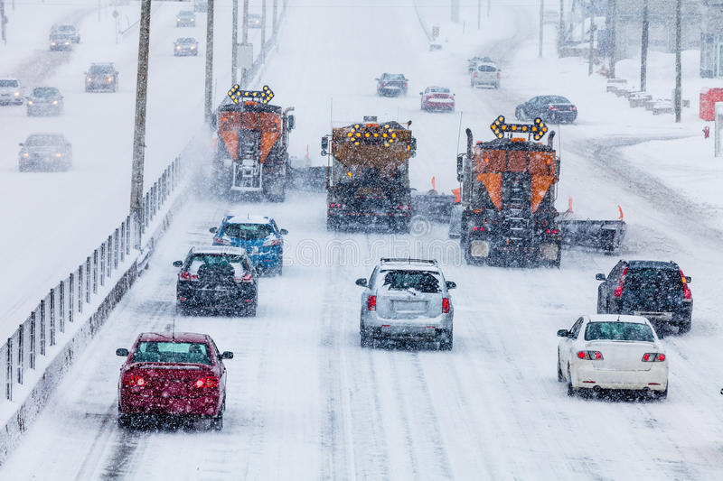 Tree Lined-up Snowplows Clearing the Highway royalty free stock photography