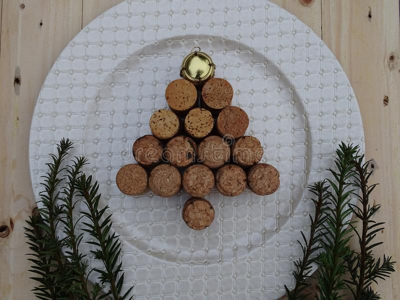 Tree made of cork stoppers on plate. And green plants golden top wooden background royalty free stock images