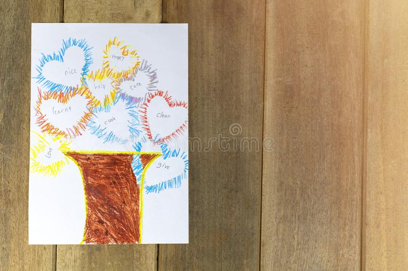 Tree of mom. draw the picture with pencil and Wood color on white paper put on wood table. Withe copy space for text or design. Abstract concept. Tree of mom stock photo