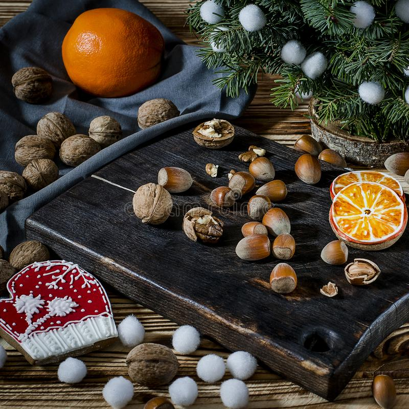 Tree, Orange, orange slices and biscuits snowflakes lie on the wood table royalty free stock image