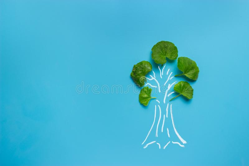 Tree painted on blue background royalty free stock photo