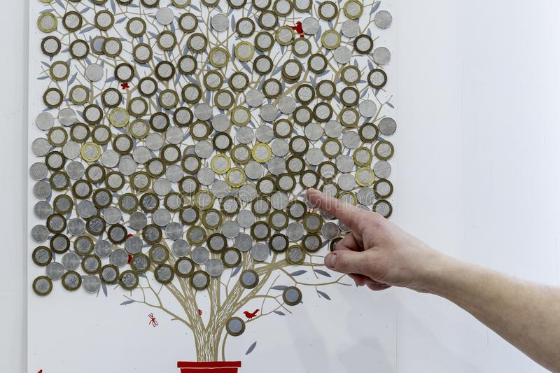 Tree painted on the wall. This Belarusian rubles. shows a finger on the money. Increase or decrease. , as well as bank deposit stock image