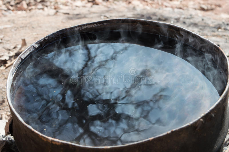 Tree reflection. Reflection of a tree on a warm water recipient used for laundery inthe Atlas region in Morocco stock image