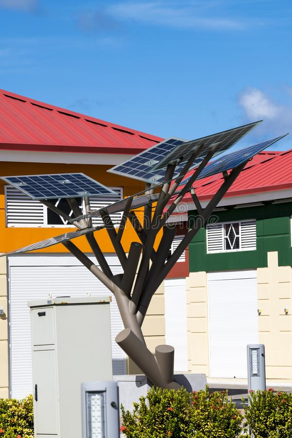 Tree sculpture with solar cells. Solar istallation in front of house in Aruba, Aruba, island in the Caribbean Sea, Lesser Antilles, constituent country of the royalty free stock images