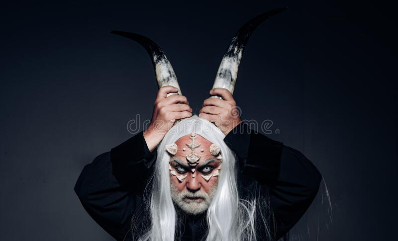 Tree spirit and fantasy concept. Man wizard with fantastic make up on demon face. Magic and fairy tale concept. Man evil royalty free stock photos
