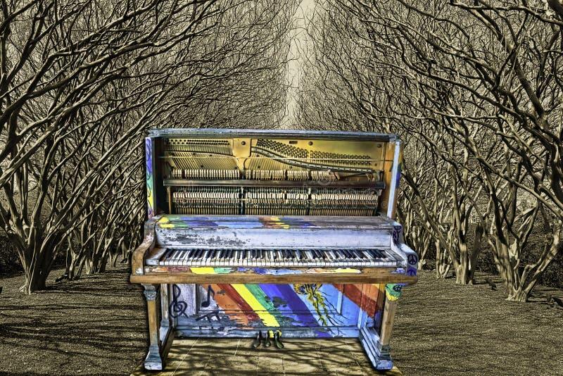 Tree Tunnel Jazz Piano. Colorful jazz piano in tree tunnel garden stock photos
