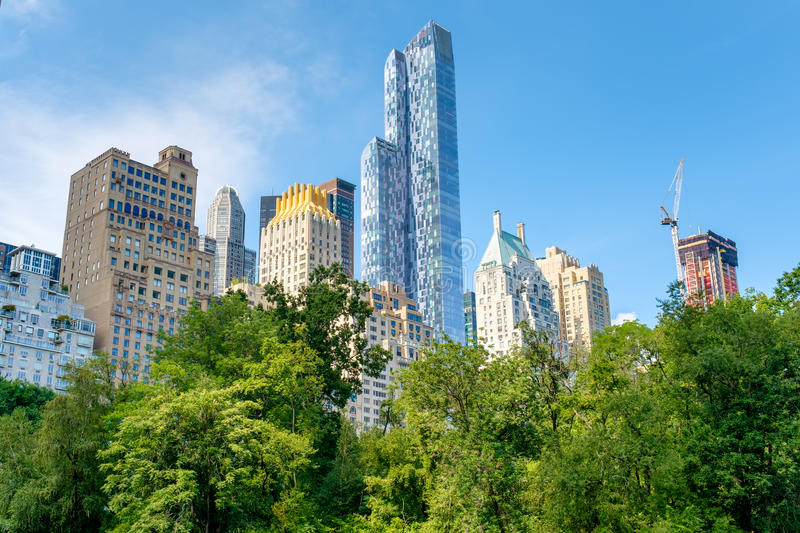Trees in Central Park with of the midtown Manhattan skyline in New York royalty free stock photography