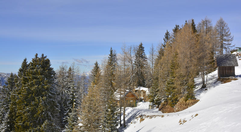 Trees and Huts on Lussari stock photography