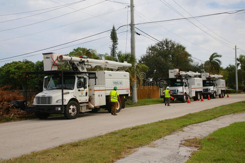 Tree Trimming Trucks after Hurricane Irma royalty free stock image