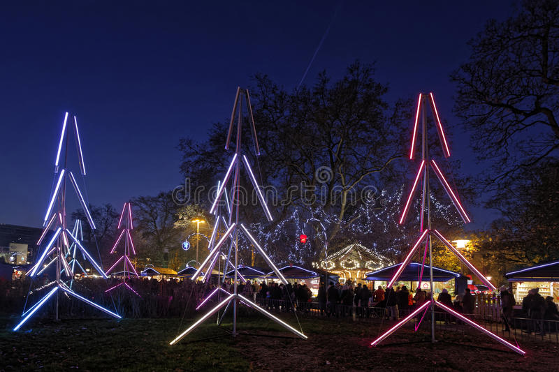 Trees of light and Christmas market of Lyon. LYON, FRANCE, December 17, 2016 : The Christmas market of Lyon, a village of more than 130 chalets on the Place royalty free stock image