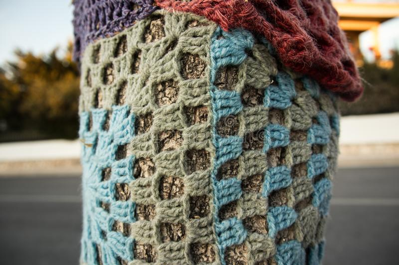 Tree with storm yarn. Colored wool texture. Street art stock photos