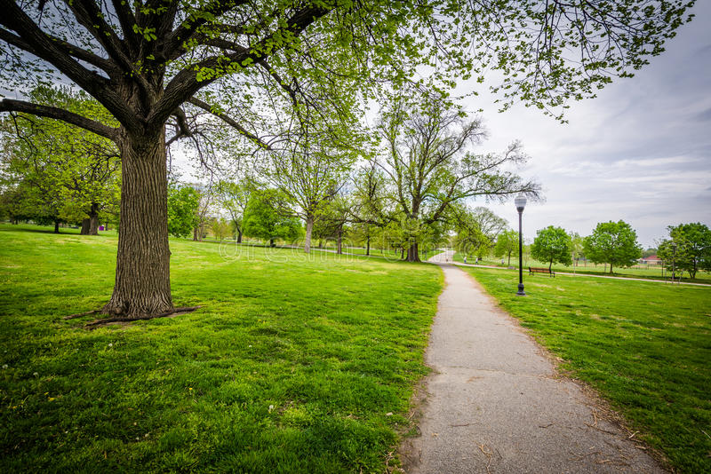 Trees and walking path at Patterson Park, Baltimore, Maryland. stock images