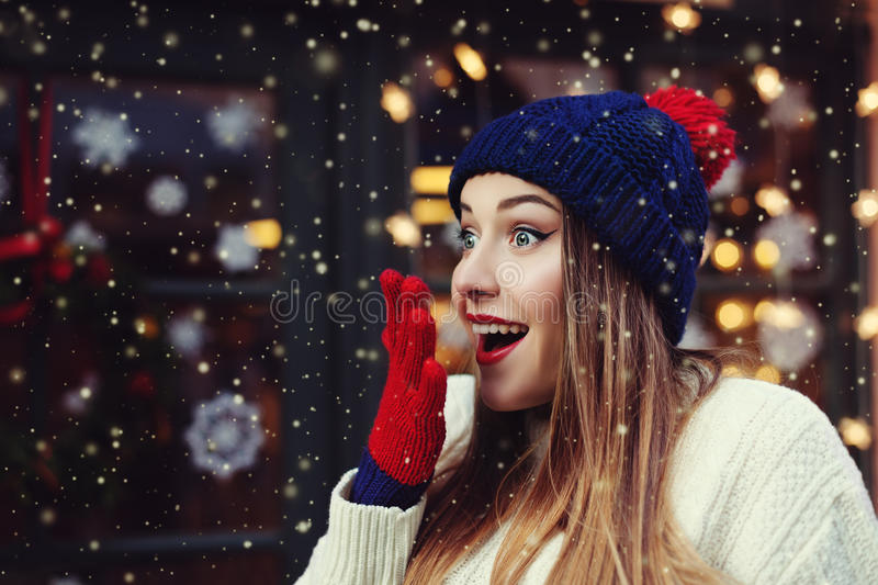Treet emotional portrait of young beautiful woman looking surprised. Lady wearing stylish classic winter knitted clothes stock image