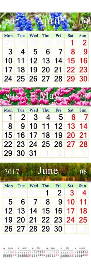 Trefaldig kalender för April May och Juni 2017 med bilder arkivbild