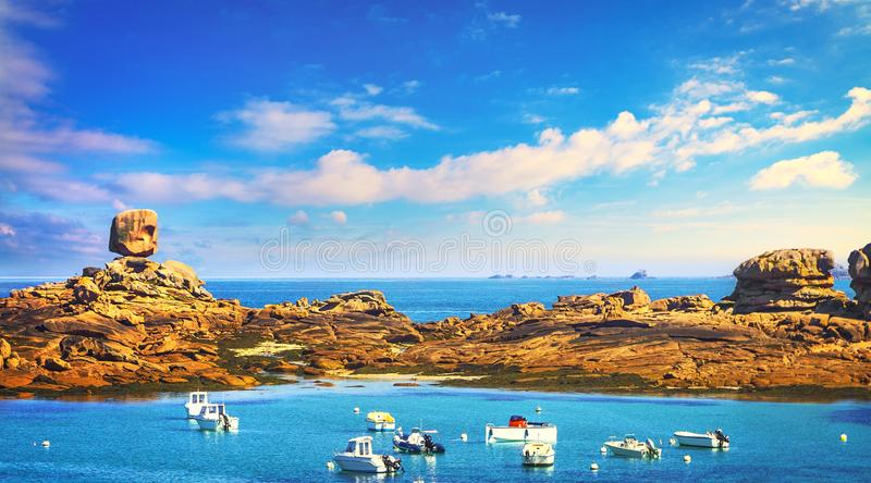 Tregastel, boat in fishing port and the dice rock. Pink granite coast, Brittany, France. Tregastel, boat in fishing port and the dice or le de rock in pink stock images