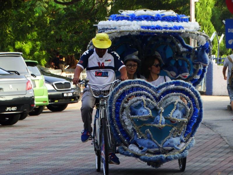 Trehjulingar på den historiska mitten av Melaka, Malaysia arkivfoto