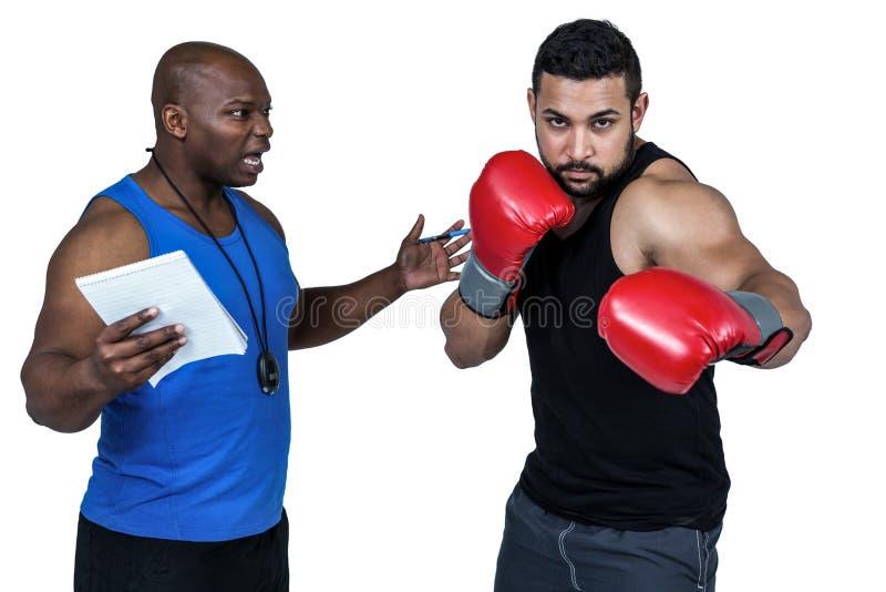 Treinador de encaixotamento com seu lutador imagem de stock royalty free