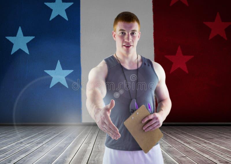 Treinador de esporte que agita sua mão contra a bandeira americana fotografia de stock royalty free
