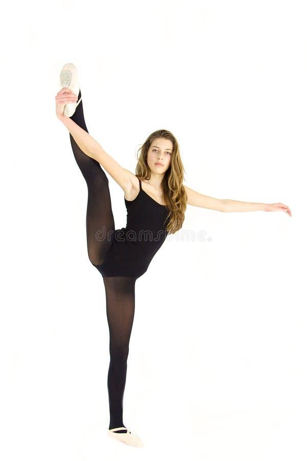 Treinamento profissional do dançarino do adolescente bonito foto de stock