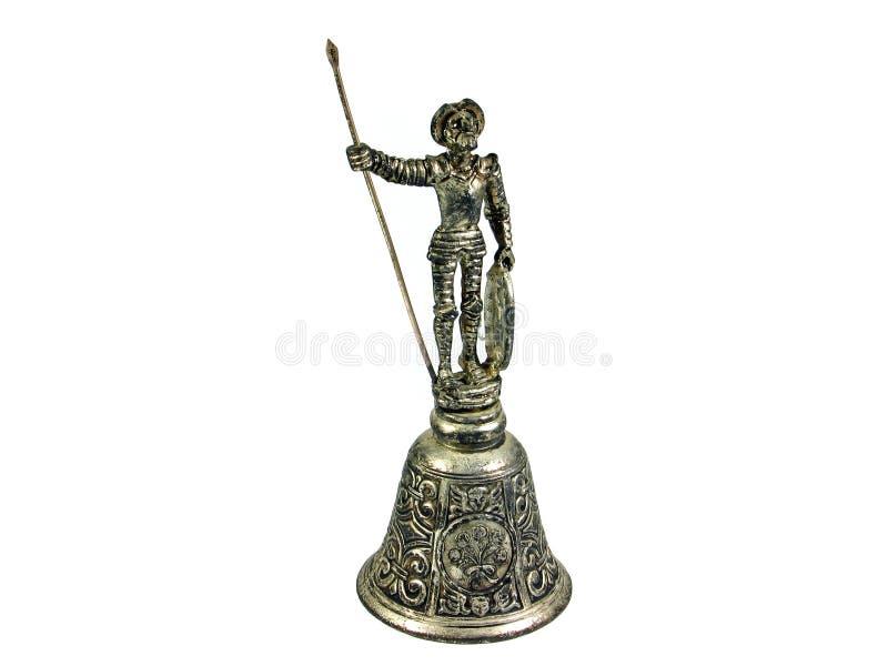Trek de klok van het het beeldjemetaal van Don Quichot aan stock afbeelding