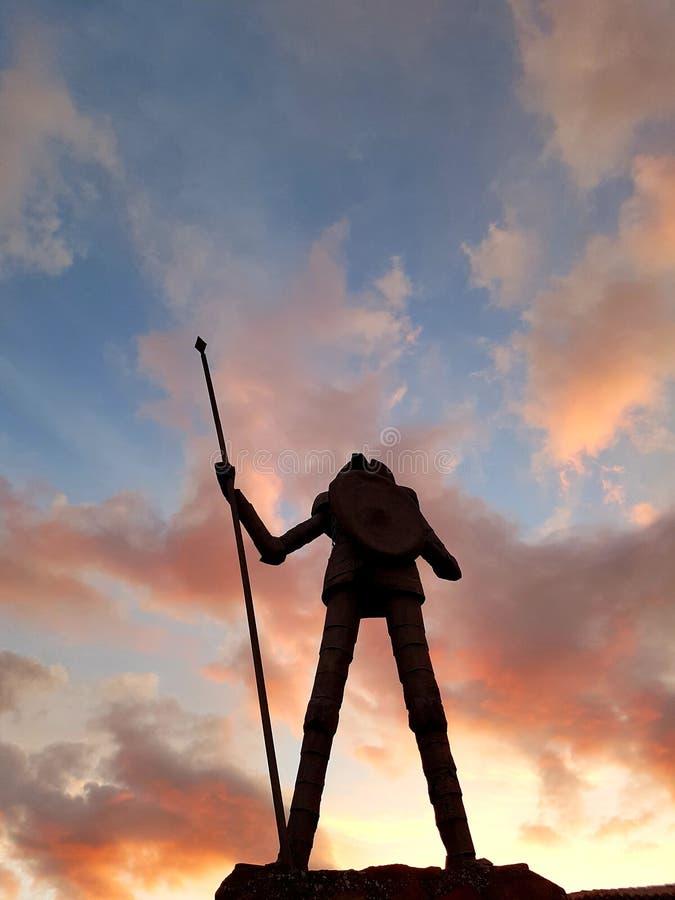Trek het standbeeld van Don Quichot aan stock foto