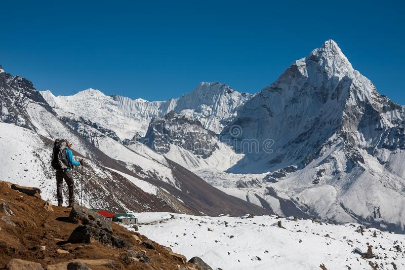 Trekker approaching Amadablam mount in Khumbu valley on a way to stock photography