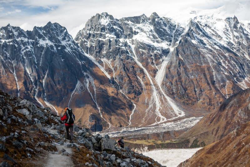 Trekker goes down fron Larke La pass on Manaslu circuit trek in. Nepal royalty free stock photography