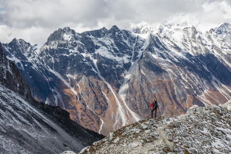 Trekker goes down fron Larke La pass on Manaslu circuit trek in. Nepal stock images