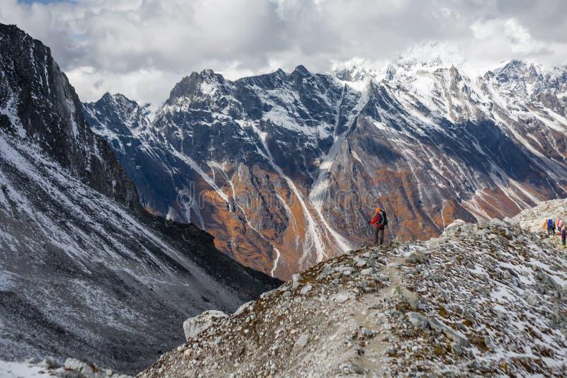 Trekker goes down fron Larke La pass on Manaslu circuit trek in. Nepal stock photos